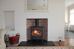Reclaimed brick slip arched chamber with natural slate tiled hearth and Clearview Vision 500 multi fuel stove, fitted in Thorpe Bay Essex 20...
