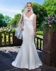 Sincerity wedding dress style 3862  Satin and venice lace fit and flare accentuated with a v-neck neckline.