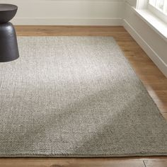 Guest house - The natural color of wool and the subtle sheen of rayon blend beautifully in this casual, low-depth rug.  Inspired by a basket weave, the loom-woven rug of low-twist yarns was carefully crafted by skilled artisans
