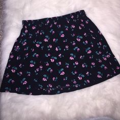 Forever 21 Floral Skirt with Pockets Black with floral design skirt. Two pockets on each side of the front. Size medium and has tags attached. Forever 21 Skirts