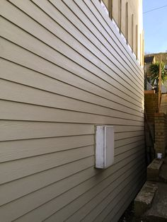 HardiePlank® Installation Taupe Whitstable | Fascia Solutions Roof Cladding, Timber Cladding, Fibre Cement Cladding, Whitstable Kent, Blinds, Taupe, Garage, Wood Cladding, Beige