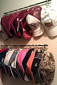 DIY:: Baseball Cap Organization  ~    Supplies:  - C-hooks (shower curtain rings; these are perfect as they actually clasp)  - curtain rod  - hats  - drill or screwdriver to adhere the poles to the wall.  - less than 10 minutes of time.    How to @  passionpinkandpea...
