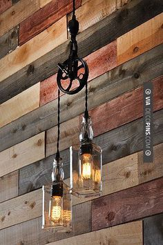 Cigar Rooms – A cool pulley pendant lamp with two whiskey bottles and vintage filament lightbulbs. Great for the bar or home decor.