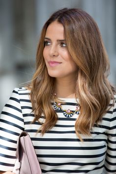 Subtle highlights over light brunette hair.