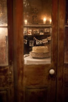give the wedding cake its own room! cake on a silver pedestal with a little pendant banner at race and religious in new orleans