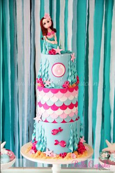 Mermaid cake - likes these colors, wants a non smiling blonde mermaid and her name
