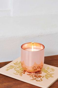 jonathan adler champagne candle in rose gold shell