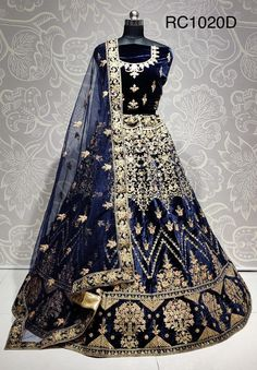 Your wedding, without a doubt is one of the most special days of your life. We understand that attire you wear that day needs to be memorable not only for you but also for the people who attend your wedding.  This velvet lehenga choli is speciall designed for the day. It is crafted with multi thread embroidary and enhanced with cancan inside. The netting dupatta adds the beauty to it.  It can be stitched in all sizes small medium large and extra large. Lehenga Choli Online, Bridal Lehenga Choli, Choli Designs, Blouse Designs, Bridal Lehenga Collection, Celebrity Gowns, Party Wear Lehenga, Traditional Sarees, Long Blouse