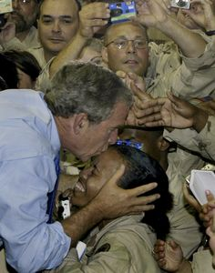 President George W. Bush kisses a soldier as he greets U. military personnel at As-Sayliyah base near Doha, Qatar, See that's a true president -leader American Presidents, American Soldiers, Us Presidents, I Love America, God Bless America, American Pride, American History, Bush Family, Support Our Troops