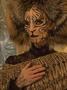 Tigris was a stylist for the Hunger Games, much like Cinna. She had worked for the capitol, and had made herself look similar to a tiger. She had taken Katniss and her gang in, even though the danger of getting killed by the capitol was enough. She had explained to Katniss why she guessed she wasn't a stylist anymore; President Snow thought she wasn't as beautiful anymore.