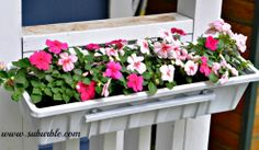 With the addition of some flower boxes full of pink impatiens, the pla…