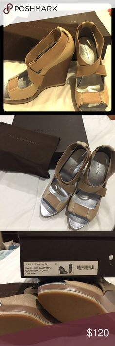 Worn once, Elie Tahiti beige canvas wedges size 8 Worn once inside, comfortable Elie Tahiti beige canvas wedges size 8 with metallic canvas. Box and shoe bags included! Strap is like that if a waistband. Elie Tahari Shoes Wedges