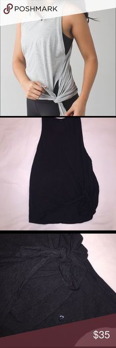 Lululemon side tie tank Dark charcoal side tie Lululemon tank! Super cute! In perfect condition! Zero tears, rips, stains, pilling etc. the side tie is adjustable! Not sure what size it is! I usually wear a 6 in tops so I am assuming that is the size. Supposed to be lose fitting! lululemon athletica Tops Muscle Tees
