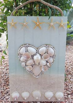 Seashell Heart - Original Beach Décor - Handpainted Ocean Collage -Mixed Media On Wood - 11 X 17 inches. This is a sweet romantic assemblage of seashells starfish sand and pearl beads. I started with carving out the heart of canvas board and wrapping it in twine. I painted it a
