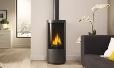 Drugasar Circo An elegant freestanding gas stove with desirable curves. Standing over 1 metre high, the Circo freestanding gas fire has a large viewing window that reveals a classic log fire with high, dramatic flames and generous warmth. Small Gas Fireplace, Gas Stove Fireplace, Freestanding Fireplace, Fireplace Inserts, Modern Fireplace, Fireplace Design, Gas Fireplaces, Freestanding Stoves, Freestanding Wall