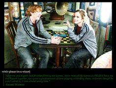 Emma and Rupert behind the scenes playing wizarding chess.
