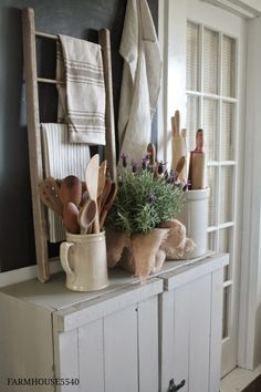 Like the idea of this small ladder and displaying vintage/favorite linens. Vintage Linens and Wooden Utensils - displayed in the kitchen on a rustic sideboard - via FARMHOUSE Farmhouse Friday ~ Farmhouse Kitchen Primitive Kitchen, Farmhouse Kitchen Decor, Farmhouse Style, Modern Farmhouse, Cottage Farmhouse, French Farmhouse, Primitive Decor, Antique Farmhouse, White Farmhouse