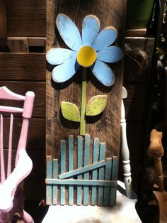 3 foot wooden flower on primitive weathered barnboard.......
