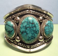 """STERLING SILVER CUFF BRACELET. NATIVE AMERICAN SIGNED RGM. 3 BEAUTIFUL BLUE TURQUOISE STONES. TESTED POSITIVE FOR STERLING SILVER. FRONT FACE IN CENTER IS 2 1/4"""" HIGH AND 1"""" IN BACK. 