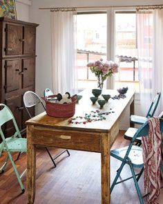 Pleasant dining room with a farmhouse feel, mismatched metal chairs
