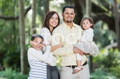 Hispanic family with two children at the park. royalty-free stock photo