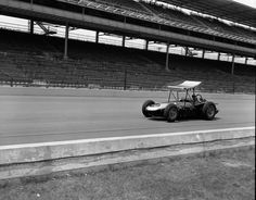 Indy 500, 1962. Jim Rathmann shakes down a winged roadster during a practice lap.