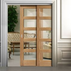 Twin Telescopic Pocket Contemporary 5L Oak Veneered Doors - Clear Glass, Prefinished.    #pcoektdoors #interiordoors  #telescopicdoors  #interiordesign  #doordesign  #newflat