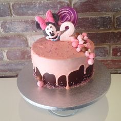 Sweet pink Minnie mouse drip cake