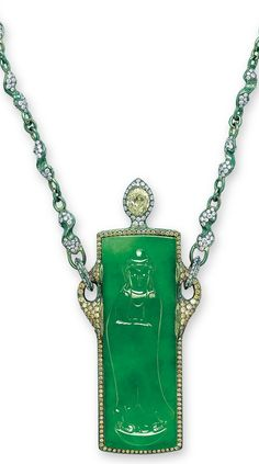 A UNIQUE MULTI-GEM 'ETERNAL JOY' PENDANT NECKLACE, BY WALLACE CHAN. Suspending a rectangular jadeite plaque well carved with a Guanyin, within a circular-cut yellow diamond surround, to the white mother-of-pearl sliding back with a pear-shaped yellow diamond surmount, joined to the neckchain with diamond-set S-shaped links, mounted in titanium, plaque 52.3 x 18.0 x 4.9 mm, necklace 59.0 cm. Signed. Hong Kong Jade & Stone Laboratory / the plaque is natural jadeite and no polymer is detected.