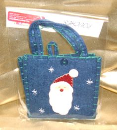 HRV Santa Bag, $3.00:  charming felt bag in dark blue with forest green accents and a Santa face embroidered on the front.  Tuck in a bag of cookies, jewelry gifts, gift cards, sachets, etc.