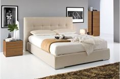 SWAMI model queen size bed with upholstered headboard and bed frame.The SWAMI bed is characterized by the wide deep-buttoned upholstered headboard. Fully covered, to offer greater comfort, it is available in EKOS (a synthetic mater Solid Wood Platform Bed, Upholstered Platform Bed, Upholstered Beds, Platform Beds, Bedroom Furniture, Home Furniture, Panel Bed, Contemporary Bedroom, Contemporary Furniture