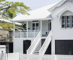 The priority for the owners of this white timber Queenslander in Brisbane was to create a luxurious home where they could fully enjoy their outdoor space. House Paint Exterior, Exterior Paint Colors, Exterior House Colors, Outdoor Areas, Outdoor Walls, Dulux Whisper White, Queenslander House, Australian Homes, Outdoor Wall Lighting