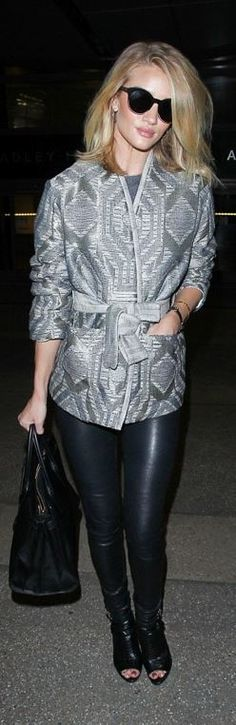 Who made  Rosie Huntington-Whiteley's black boots, gray jacket, sunglasses, gold jewelry, watch, leather pants, and booties?