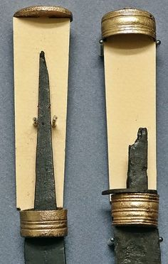 Items recovered from Ejsbøl, Denmark. Like other bog deposits, Ejsbøl contains finds of sacrificed equipment from defeated armies dating from the 1st to the 5th century.  These items are from Ejsbøl II, dated to the late 4th/early 5th century.  Copper alloy knife handle fittings.  Matt Bunker - Wulfheodenas