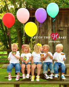 The cousins photo shoot with sweet treats & balloons - love the different colored converse