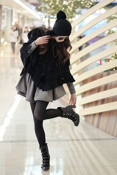woolen knitted poncho + thick woolen dress and tights...yup I'm doin this style come fall...