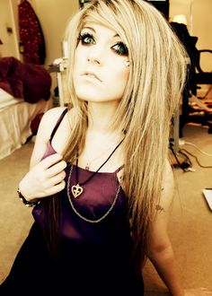 She reminds me of Avril Lavigne. She is so pretty though