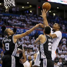 Oklahoma City's Kevin Durant (35) shoots against San Antonio's Tony Parker (9) and Tim Duncan (21) during Game 3 of the Western Conference semifinals between the Oklahoma City Thunder and the San Antonio Spurs in the NBA playoffs at Chesapeake Energy Arena in Oklahoma City, Friday, May 6, 2016. San Antonio won 100-96. Photo by Nate Billings, The Oklahoman