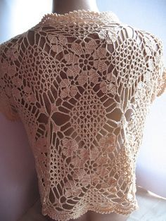 Openwork сrochet bolero shrug is made of mercerized cotton in pale yellow color. It will be a perfect complement to summer clothes - blouses, shirts, sundresses. The front edge of the bolero can be fastened with a brooch, pin or laces. Eco, romantic and sexy style.    U.S. size: M-L. Ready to ship. Care instructions: Hand wash in warm water with mild detergent. Do not twist or wring. Dry flat.    You can find more elegant handmade items in our shop…