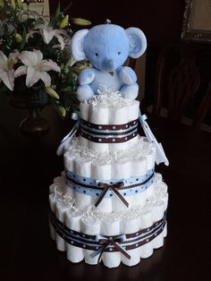 PLEASE READ STORE ANNOUNCEMENT BEFORE PLACING AN ORDER: This Cute Blue & Brown Elephant Diaper Cake Is the perfect centerpiece for Blue