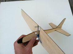 This balsa wood glider catapults up with wings folded back, wings pop open and it gently glides down. Paper Airplane Folding, Rc Plane Plans, Paper Aircraft, Airplane Crafts, Wood Plane, Woodworking Projects For Kids, D Craft, Model Airplanes, Gliders