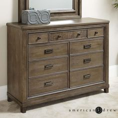 Contemporary 9-Drawer Dresser with Drop Top Center Drawer with Media Storage