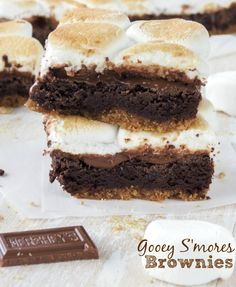 Gooey S'mores Brownies. Super fudgy brownies with a buttery graham cracker crust and chocolate bars on top that act almost as a fudge-like layer, topped with some toasted marshmallows! - Sprinkle Some Sugar