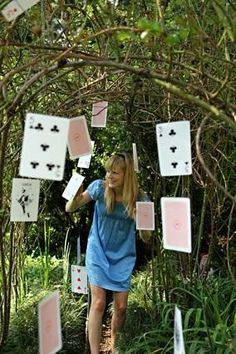 to hang along the side garden path of our house for an alice in wonderland party!