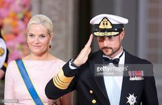 Crown Princess MetteMarit and Crown Prince Haakon of Norway leave the Royal Chapel at The Royal Palace in Stockholm after the wedding of Prince Carl...