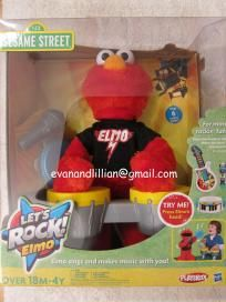 Sesame Street LET'S ROCK ELMO by Hasbro      Features:  -Elmo comes with his microphone, a tambourine, and a drum set  -Elmo interacts with other Let's Rock instruments (not included)  -Elmo can sing 6 different songs!    Recommended Age: 18 months and up
