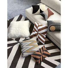 "<span class=""copyHeader"">bolt of gold.</span> The Groove Wool Pillow was designed exclusively for CB2 in collaboration with Kravitz Design by Lenny Kravitz. Each piece is inspired by Lenny's eclectic global lifestyle and the furnishings from his homes in Paris, Brazil and the Bahamas. A collection that turns up the volume, the '70s-inspired designs capture the sleek glam of New York club culture and the natural ease of the California music scene. Woven as a traditional dhurrie, Groove…"