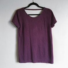 F21 low back maroon t-shirt Very cute maroon/burgundy low back t-shirt from forever 21. Great condition, only worn a couple times. It is a thicker material and really soft! It is a size small but would also fit a medium. ❌no trades. Forever 21 Tops Tees - Short Sleeve