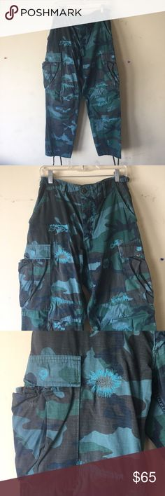 CCO Ron Herman Vintage Camo Pants Camo pants by Ron Herman Vintage. NWT and in perfect condition. Adjustable straps on waist band allows a flexible fit. Camo is different shades of green. (Actual Camo colors). Stitching details are an aqua blue- like color. #K171 Ron Herman Pants