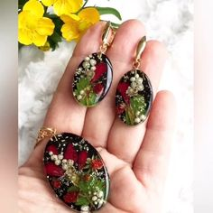 Gorgeous resin earring and necklace pendant set. Featuring brightly coloured botanicals set against a jet black background. Resin Necklace, Resin Jewelry, Jewelry Crafts, Beaded Jewelry, Handmade Jewelry, Earrings, Epoxy Resin Art, Uv Resin, Plastic Resin